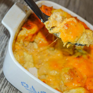 This Cheesy Egg Casserole is an easy recipe to put together the night before and adding your favorite breakfast meat and vegetables can make it even better.