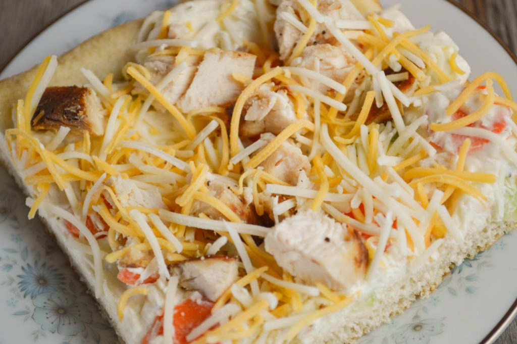 Adding grilled chicken turns the classic cream cheese vegetable bars with a crescent roll crust into this delicious Chicken Ranch Vegetable Pizza.