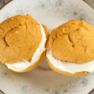 Pumpkin Whoopie Pies with a cream cheese filling are the perfect fall treat. The best part of this recipe is leave out the filling and have pumpkin cookies!