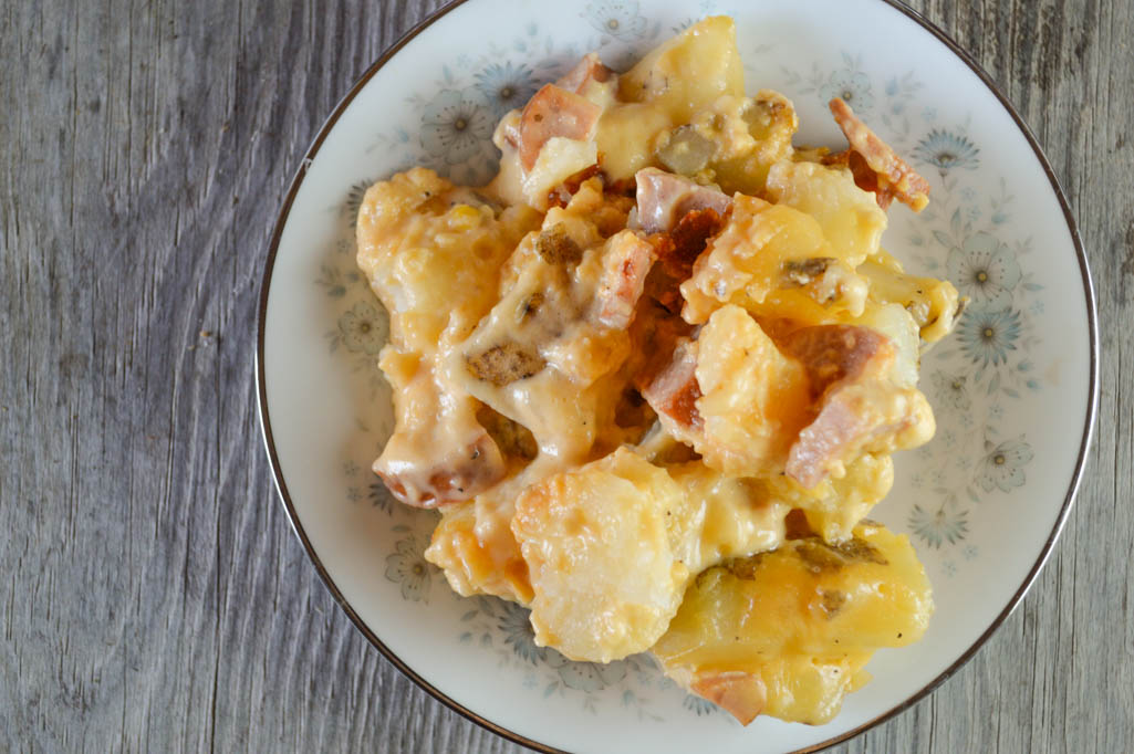 Crock Pot Cheesy Smoked Sausage and Potato Bake is comfort food at its best with a creamy cheese sauce topping family-pleasing ingredients.