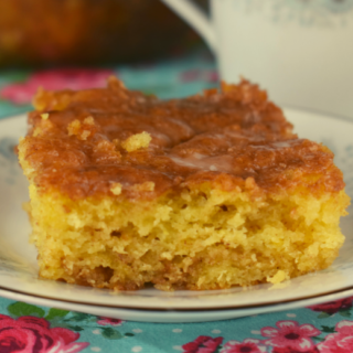 This Honey Bun Coffee Cake recipe takes a box of yellow cake mix and adds a couple extra ingredients to turn it into a delicious breakfast or dessert treat.
