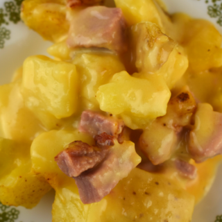 Mom's Cheesy Ham and Potato Casserole was an all-time favorite recipe at our house growing up. Mom traditionally made this with leftover ham after the holidays. This stick-to-your-ribs meal will warm you up on a cold winter day and is the perfect casserole for a new mom or sick friend.