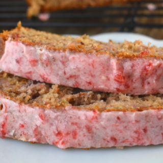 Strawberry Bread with Frozen Strawberries is an easy quick bread with incredible strawberry flavor. The thawed strawberries give it a moist texture, and the easy strawberry glaze is a sweet and flavorful. You'll want to eat this for breakfast, dessert and every meal in between.