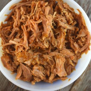 Quick Crock Pot Pulled Pork is a 3-ingredient entree that can be tossed in the slow cooker in a matter of minutes. This simple meal packs a flavor punch with perfectly seasoned pork that's tossed in your favorite barbecue sauce.