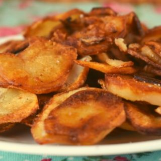 This Crispy Fried Potatoes recipe starts with raw potatoes and ends with a perfectly pan-fried potato. Serve with ketchup for the perfect side dish.