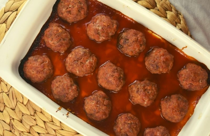 Old Fashioned Ham Balls are made with ground pork, beef and ham with a surprise sweetness coming from graham cracker crumbs.