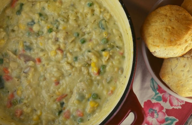 Debbie's Chicken Goop is a crustless chicken pot pie stew that gets served along side of biscuits. It's a hearty chicken dinner that will become a requested staple in your house.
